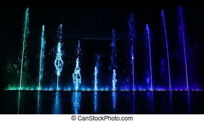 Dancing fountain. - Dancing fountain show with reflection....
