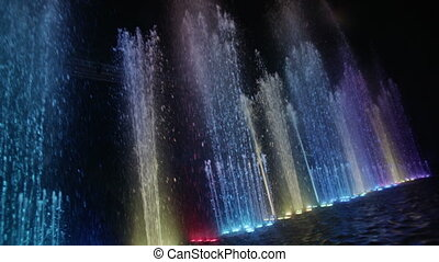 Dancing fountain. Diagonal wide shot. Slow motion.