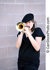 Female trumpet player. - Female trumpet player blowing her...