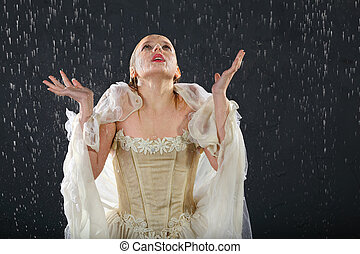 beautiful girl wearing in dress with corset freezes in rain...
