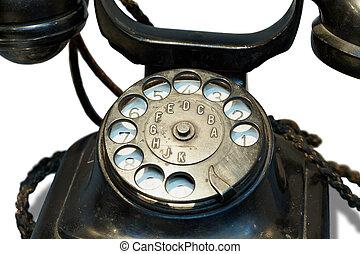 Old-fashioned desktop black phone.