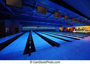 Empty bowling club, lot of bowling lanes with skittles, blue...