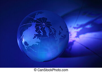 Small blue glass globe at stand is illuminated; North...