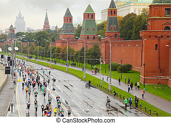 MOSCOW, RUSSIA - SEPTEMBER 12: Running people on Kremlin...