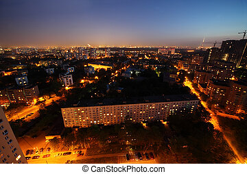 Buildings at night in Moscow, Russia; panorama of city;...