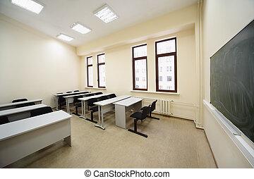Empty beige classroom with wooden school desks, simple black...