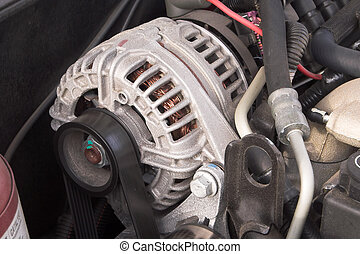 Alternator - The power plant or alternator of an automobile.