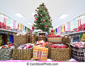 Shelves with variety of Christmas-tree decorations inside large supermarket
