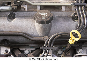 Oil Cap & Dipstick - The oill cap and dipstick of an...