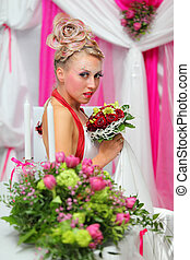 beautiful young bride with bouquet of red roses wand original makeup