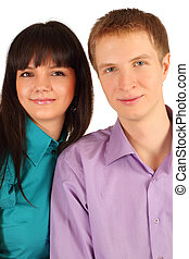 Young man and woman smile isolated on white background; focus on man