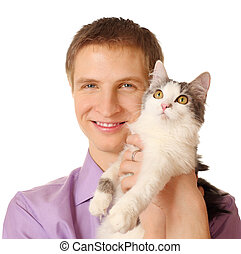 Smiling young man holds cat isolated on white background; cat looks up