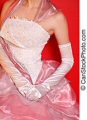 Corset of beautiful wedding dress with pink skirt on red background
