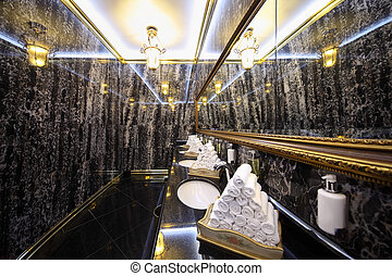 MOSCOW - APRIL 27: Toilet with black marble walls in Hotel...
