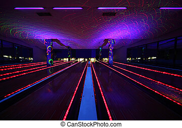 several bowling alleys inside dark and beautiful bowling...