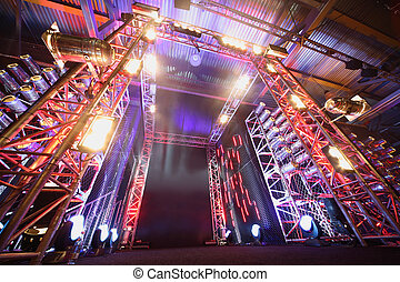 Illuminated way to boxing ring inside fight club;...