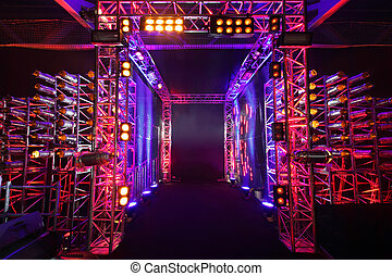 Multi-colored illuminated way with grid to boxing ring...