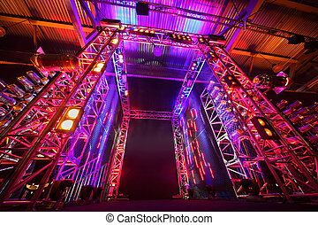 Multi-colored illuminated way to boxing ring inside fight...