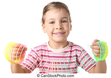 beautiful little girl playing with colorful plastic spring...