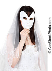 Beautiful young bride hid her face behind white mask isolated on white background