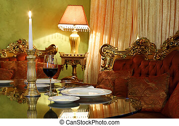 glass with wine and candlestick with candle at table, red...