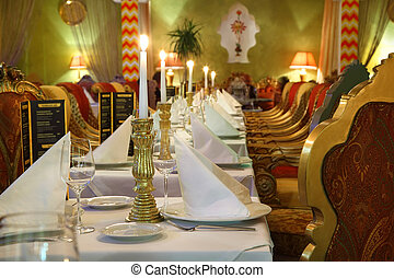 long table with serving and beautiful chairs in eastern...