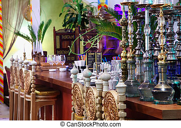 hookahs in eastern luxury restaurant with beautiful...