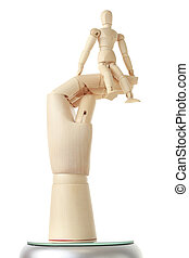 wooden mannequin sitting on big wooden hand isolated on...