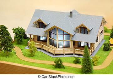 Small model of cottage with exterior - trees, bushes and path