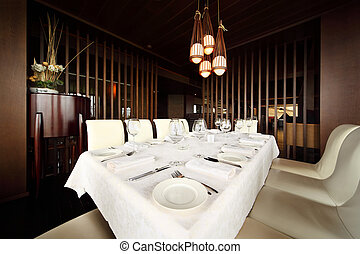 beautiful serving at table with white tablecloth in empty...