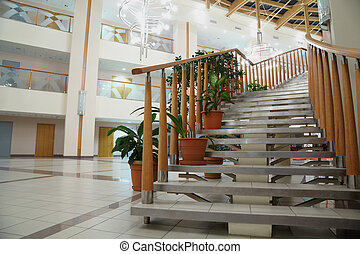 staircase with wooden banisters in a large light hall