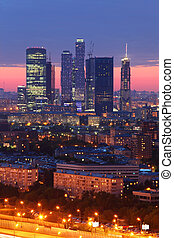 Buildings of Moscow City complex of skyscrapers at evening in Moscow, Russia; beautiful sunset