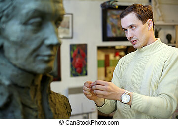Sculptor works in the studio on a bust of of A.V. Suvorov -...