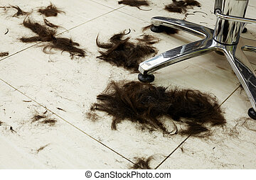 Cut hair on the floor in a hairdressing salon