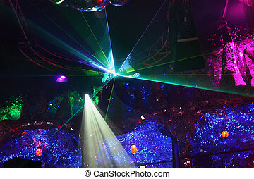 Beautiful colorful rays on ceiling, unusual wall decoration in night club