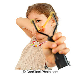Girl with slingshot aim to camera isolated on white...