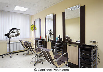 Barbershop room with three working places in the beauty...