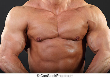 Strong chest and hand muscles of undressed tanned...