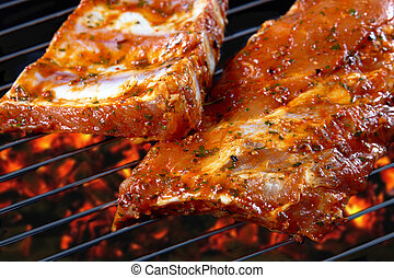 raw pork ribs on grill