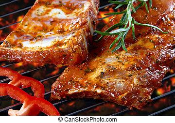raw pork ribs on grill