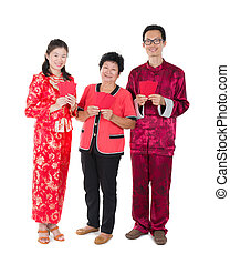 chinese new year family with ang pow symbol of luck