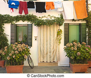 Italy, Burano: house and laundry hanging - Italy, Burano:...