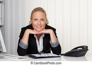young successful woman in an office - a young successful...