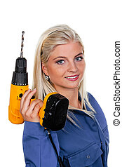 woman in blue work clothes with a drill - young woman in...