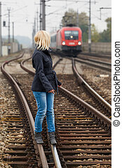 woman balancing on track. decisions - in search of the right...