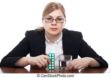 Serious woman with pills