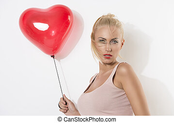 sexy blonde girl  with balloon and hair on the face