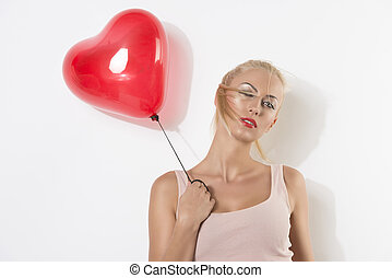sexy blonde girl with balloon and hand near the shoulder