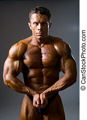 Bodybuilder showing his muscles, closeup