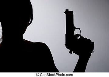 Silhouette of a woman with a gun on a gray background.